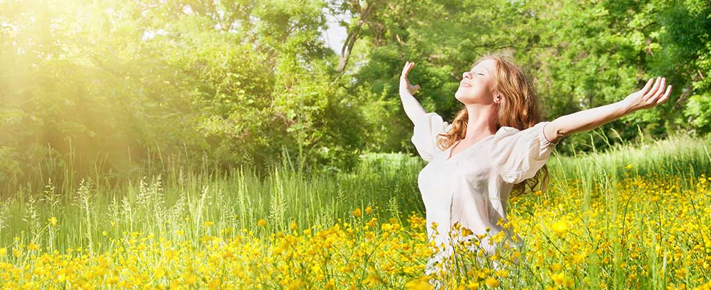 woman happy in field of flowers